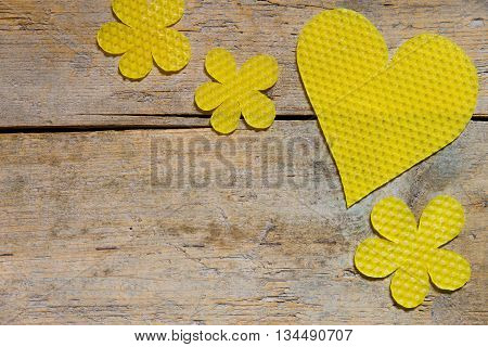 Beeswax, Heart And Flowers On Wooden Table
