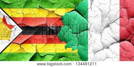 Zimbabwe flag with Italy flag on a grunge cracked wall