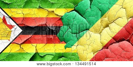 Zimbabwe flag with congo flag on a grunge cracked wall