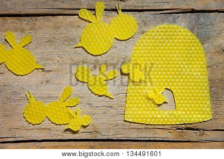 Beeswax, Bees And A Beehive On Wooden Table