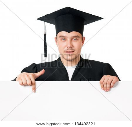 Graduate student in mantle showing blank placard board, isolated on white background