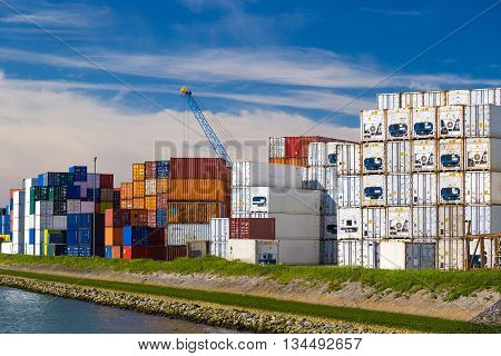 Cargo Containers Stacked In Port Of Rotterdam