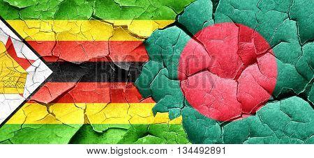 Zimbabwe flag with Bangladesh flag on a grunge cracked wall