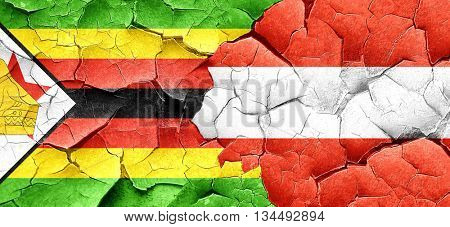 Zimbabwe flag with Austria flag on a grunge cracked wall
