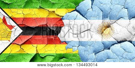 Zimbabwe flag with Argentine flag on a grunge cracked wall