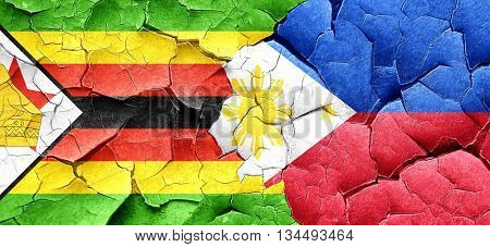 Zimbabwe flag with Philippines flag on a grunge cracked wall