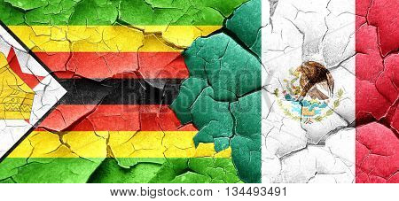 Zimbabwe flag with Mexico flag on a grunge cracked wall