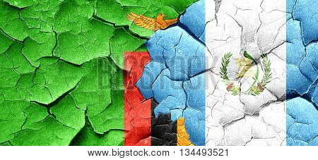 Zambia flag with Guatemala flag on a grunge cracked wall