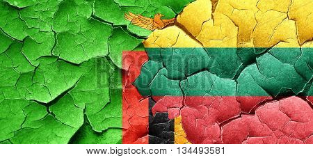 Zambia flag with Lithuania flag on a grunge cracked wall