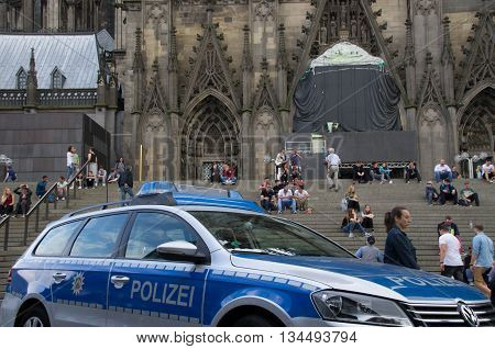 Cologne, Germany - June 11, 2016: Police patrol car infront of Cologne cathedral.
