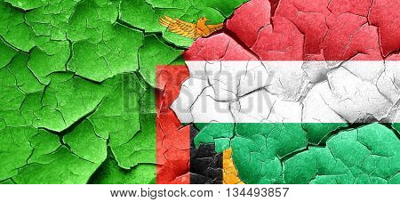 Zambia flag with Hungary flag on a grunge cracked wall