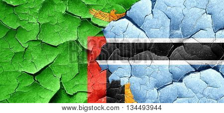 Zambia flag with Botswana flag on a grunge cracked wall