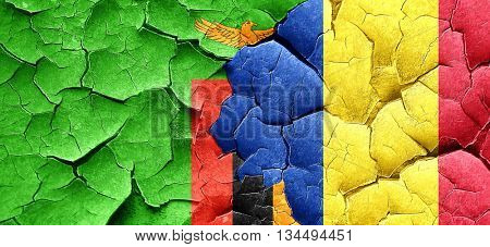 Zambia flag with Romania flag on a grunge cracked wall