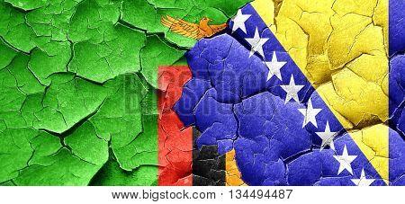 Zambia flag with Bosnia and Herzegovina flag on a grunge cracked