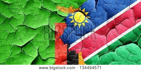 Zambia flag with Namibia flag on a grunge cracked wall