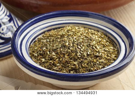 Bowl with Moroccan mixture of different dried herbs called zatar