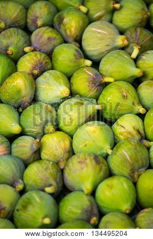 Fresh ripe green figs closeup background. Low depth of field
