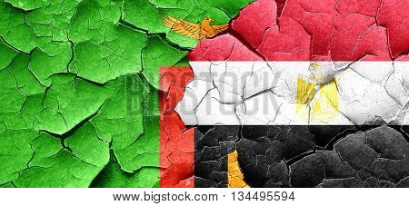 Zambia flag with egypt flag on a grunge cracked wall