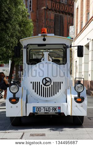 Albi France - June 9 2016: White Trackless Train for Sightseeing in the Streets of Albi Commune in Southern France