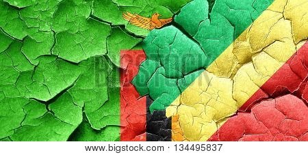 Zambia flag with congo flag on a grunge cracked wall