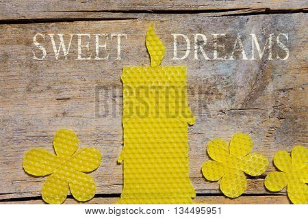 Beeswax, Candle And Flowers On Wooden Table, Sweet Dreams