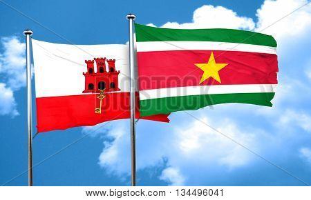 gibraltar flag with Suriname flag, 3D rendering