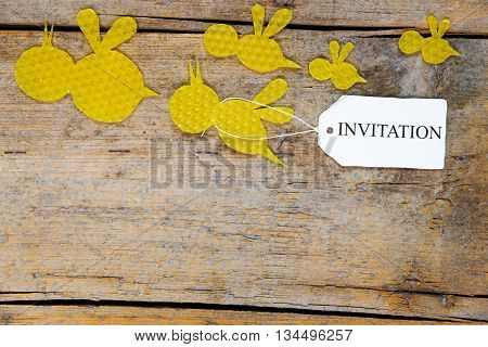 Beeswax, Flying Bees On Wooden Table, Sign With Word Invitation