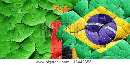 Zambia flag with Brazil flag on a grunge cracked wall