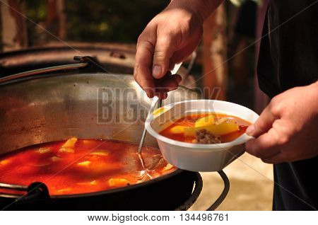 One ration Traditional Goulash soup in the garden