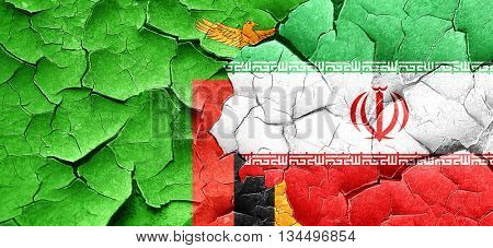 Zambia flag with Iran flag on a grunge cracked wall