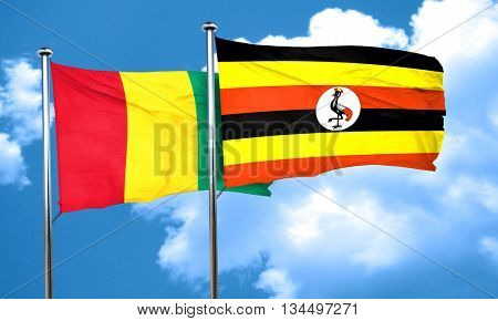 Guinea flag with Uganda flag, 3D rendering