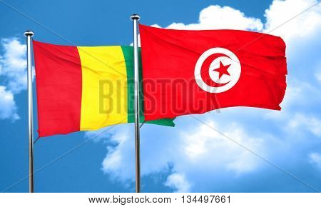 Guinea flag with Tunisia flag, 3D rendering