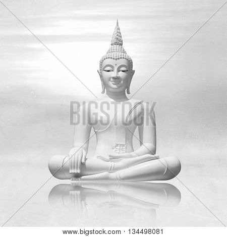 White buddha in lotus position against light grey sky background - meditation concept
