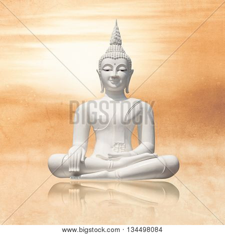 Sitting buddha in lotus position at sunrise - calm meditation concept