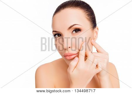Portrait Of Young Attractive Woman Touching Her Face And Looking For Acne