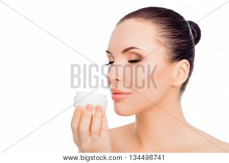 Portrait Of Beautiful Sensual Woman Smelling Jar With Cream