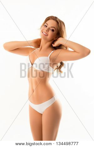 Sensitive Smiling Young Woman Showing Her Body In White Lingerie