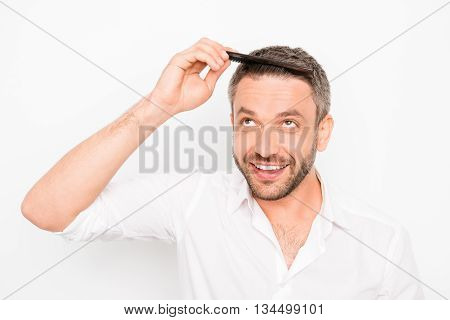 Handsome Young Man Combing His Hair With Comb