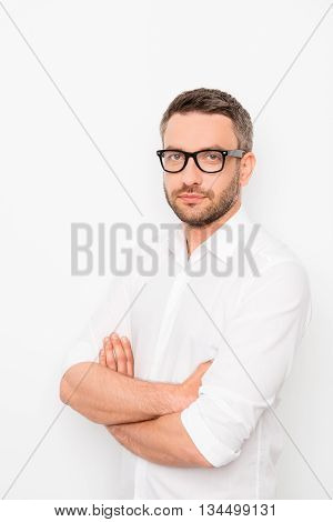 Portrait Of Confident Young Handsome Businessman In Glasses  With Crossed Hands