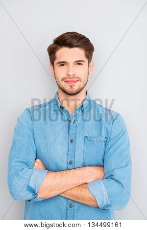 Portrait Of Handsome Young Successful Businessman With Crossed Hands