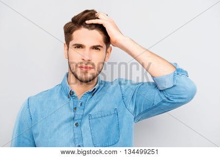 Attractive Man Touching His Hair On Gray Background
