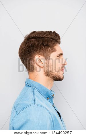 Side View Portrait Of Handsome Man In Blue Shirt