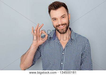 Cheerful Young Successful Man Showing
