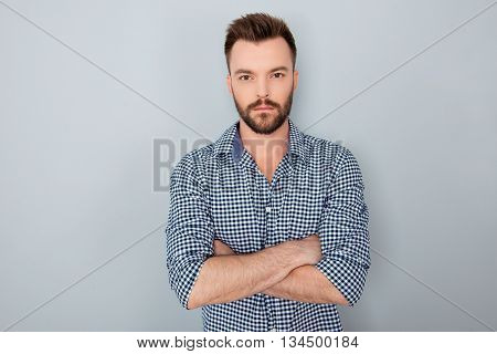 Portrait Of Confident Bearded Businessman With Crossed Hands