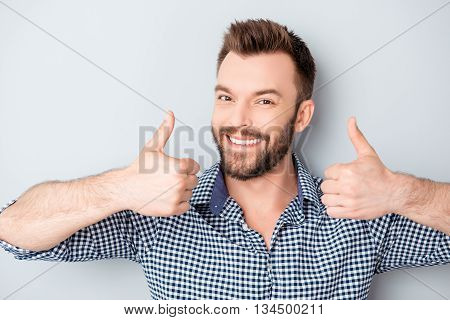 Portrait Of Cheerful Young Bearded Guy Gesturing