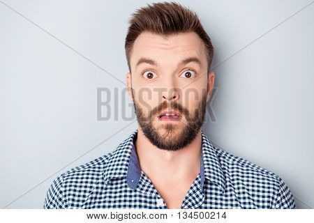 Portrait Of Shocked Young Bearded Guy With Open Mouth