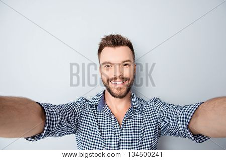 Cheerful Handsome Bearded Young Man Making Selfie