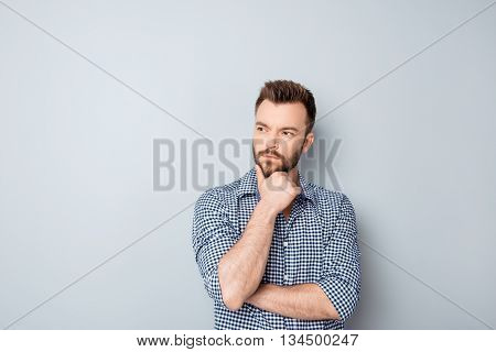 Handsome Ponder Young Businessman Isolated On Gray Background