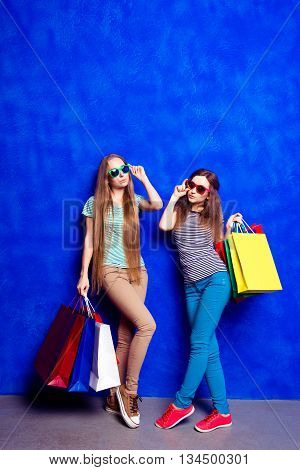 Two Pretty Women With Paperbags Doing Shopping In The Mall