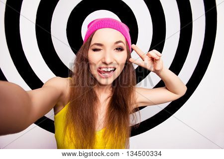 Beautiful Girl With Beaming Smile In Pink Cap Making Selfie And Winking